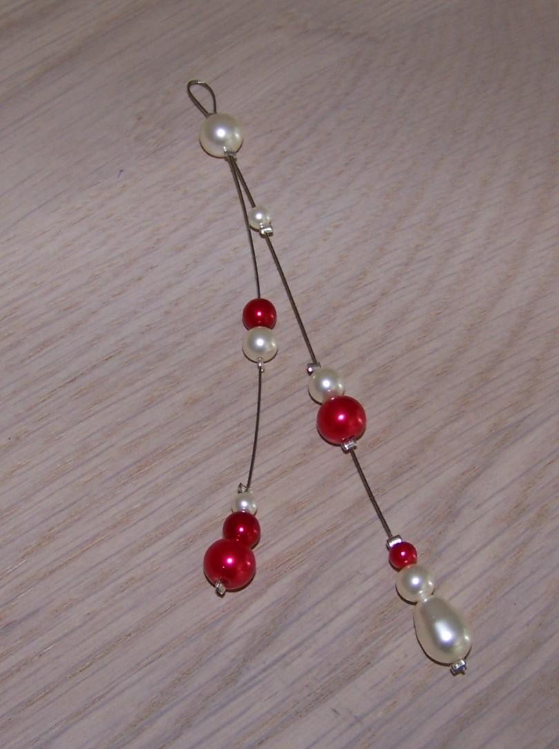 Bijou de dos perles rouge nacrée
